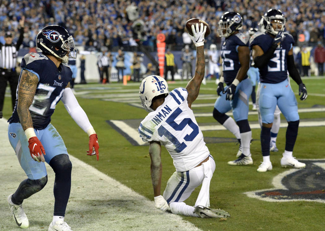 Indianapolis Colts wide receiver Dontrelle Inman (15) celebrates after catching an 11-yard touchdown pass against the Tennessee Titans in the first half of an NFL football game Sunday, Dec. 30, 20 ...