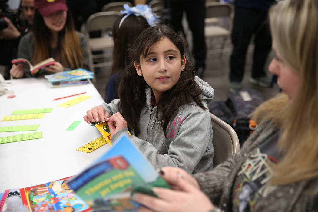 Genesis Rocha, 8, during a visit to Spread the Word Nevada offices and warehouse in Henderson, Thursday, Jan. 17, 2019. Carlos Santana's Milagro Foundation made a donation to provide more than 15, ...
