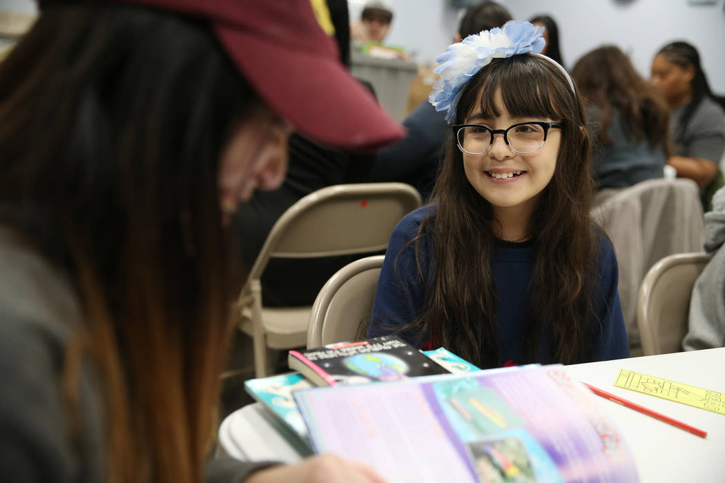 Kelary Escobar, 10, during a visit to Spread the Word Nevada offices and warehouse in Henderson, Thursday, Jan. 17, 2019. Carlos Santana's Milagro Foundation made a donation to provide more than 1 ...