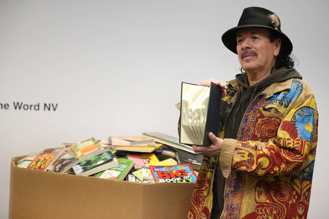Carlos Santana poses for a photo during a visit to the Spread the Word Nevada offices and warehouse in Henderson, Thursday, Jan. 17, 2019. Santana's Milagro Foundation made a donation to provide m ...
