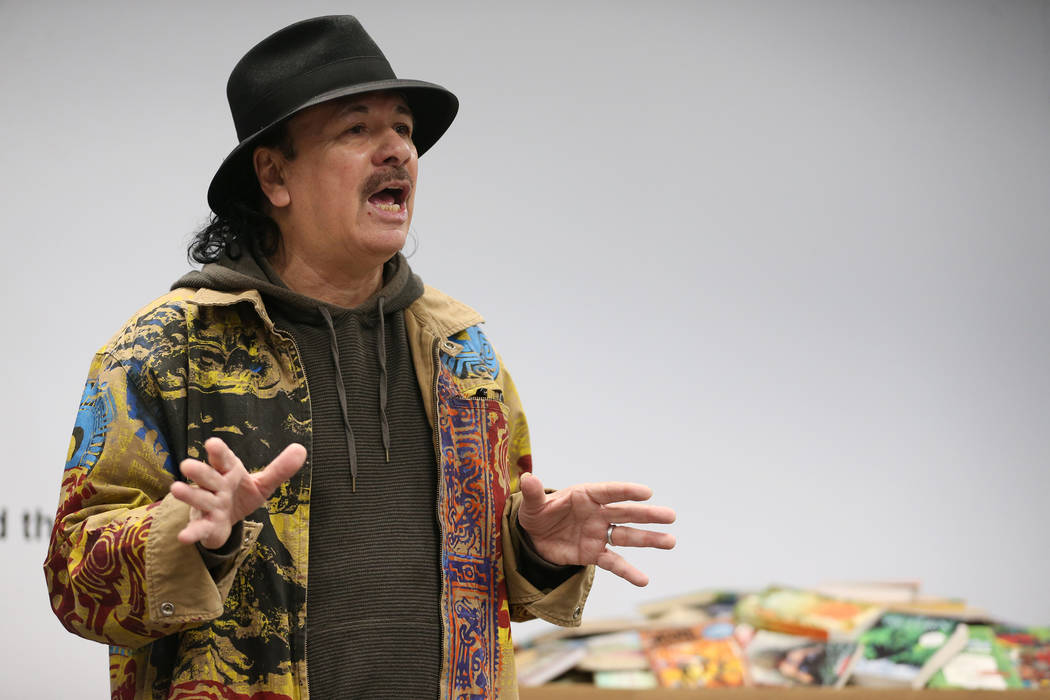 Carlos Santana speaks during a visit to the Spread the Word Nevada offices and warehouse in Henderson, Thursday, Jan. 17, 2019. Santana's Milagro Foundation made a donation to provide more than 15 ...