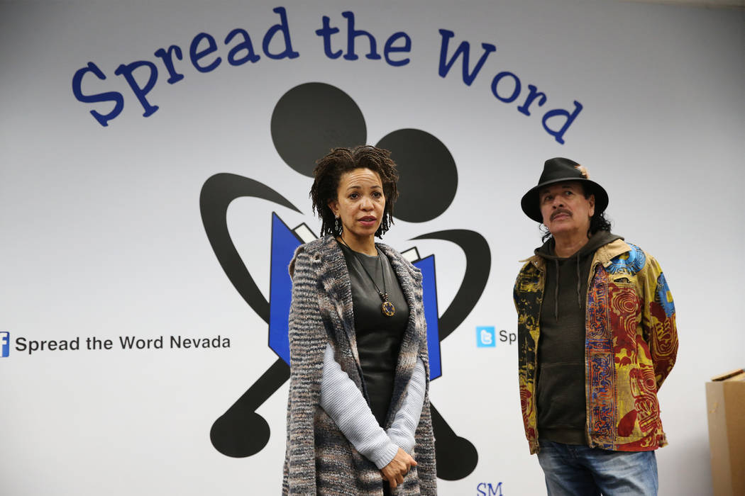 Carlos Santana, right, with his wife Cindy Blackman Santana, speak during a visit to the Spread the Word Nevada offices and warehouse in Henderson, Thursday, Jan. 17, 2019. Santana's Milagro Found ...