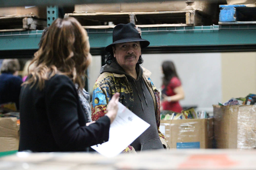 Carlos Santana tour the Spread the Word Nevada offices and warehouse in Henderson, Thursday, Jan. 17, 2019. Santana's Milagro Foundation made a donation to provide more than 15,000 books to 57 sch ...