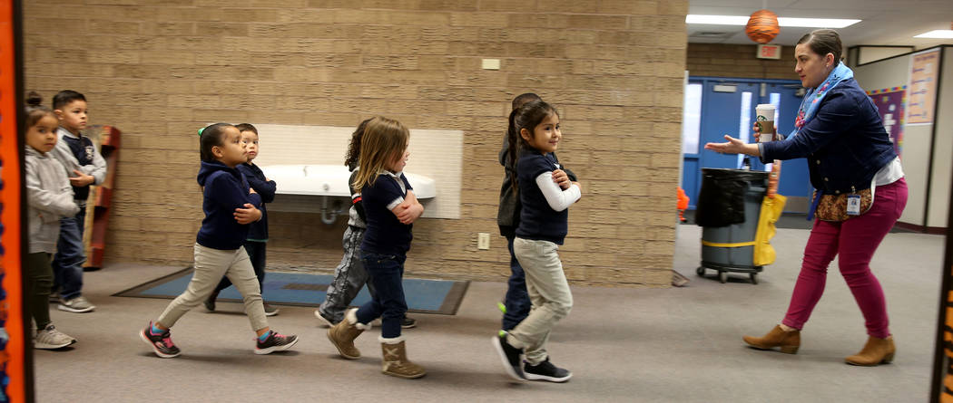 Prekindergarten teacher Leigh Todd leads her students to class at Tate Elementary in Las Vegas Thursday, Jan. 17, 2019. (K.M. Cannon/Las Vegas Review-Journal) @KMCannonPhoto