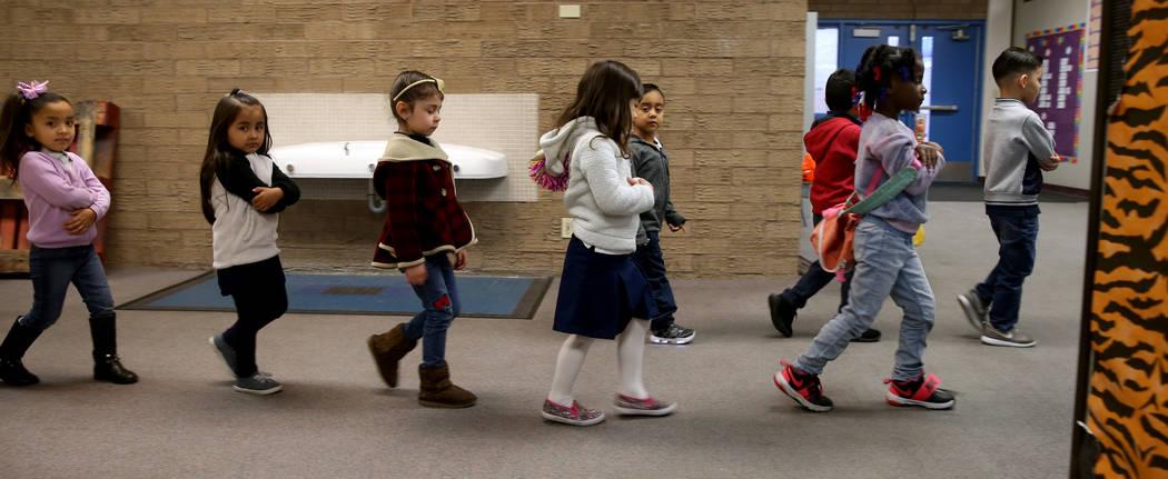 Leigh Todd's prekindergarten students walk to class at Tate Elementary in Las Vegas Thursday, Jan. 17, 2019. (K.M. Cannon/Las Vegas Review-Journal) @KMCannonPhoto