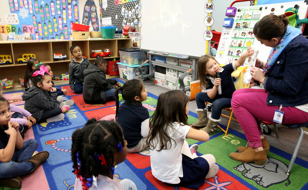Prekindergarten student Iris Vazquez talks about her project with teacher Leigh Todd at Tate Elementary in Las Vegas Thursday, Jan. 17, 2019. At left is Fernanda Aguerre Sanchez. (K.M. Cannon/Las ...
