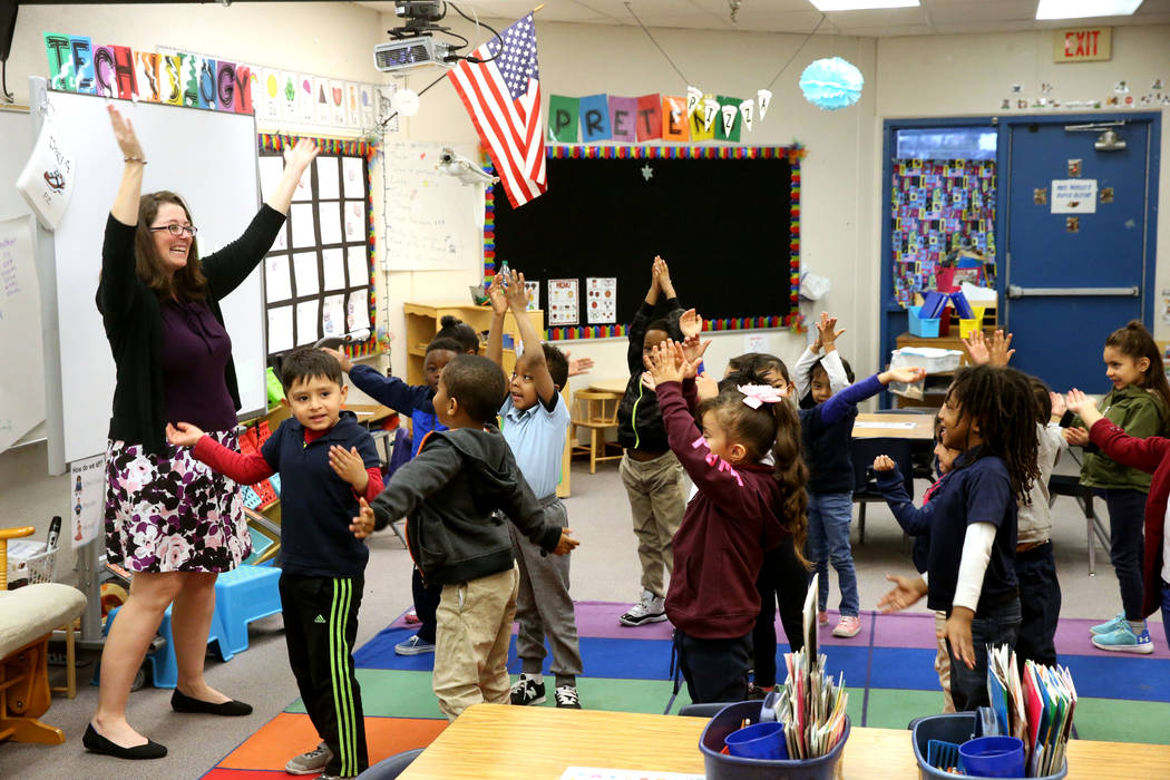 Kindergarten teacher Virginia Mosier does a physical aspect of a writing exercise with her students at Tate Elementary in Las Vegas Thursday, Jan. 17, 2019. (K.M. Cannon/Las Vegas Review-Journal) ...
