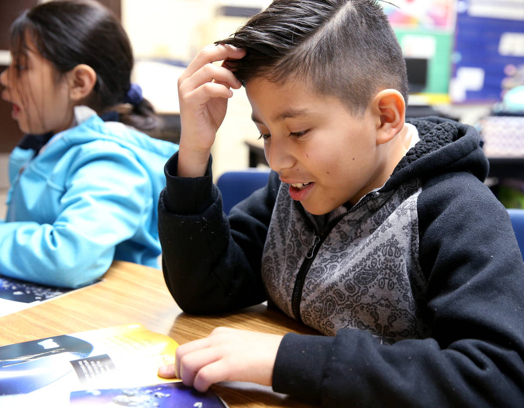 Second grader Christopher Olguin reads in the Zoom Reading Center at Tate Elementary in Las Vegas Thursday, Jan. 17, 2019. (K.M. Cannon/Las Vegas Review-Journal) @KMCannonPhoto