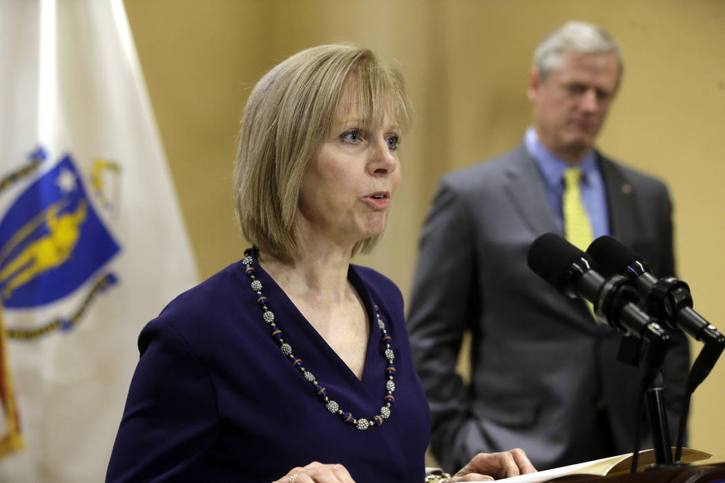 Newly appointed Chair of the Massachusetts Gaming Commission Cathy Judd-Stein, left, faces reporters as Mass. Gov. Charlie Baker, right, looks on during a news conference held to announce the appo ...