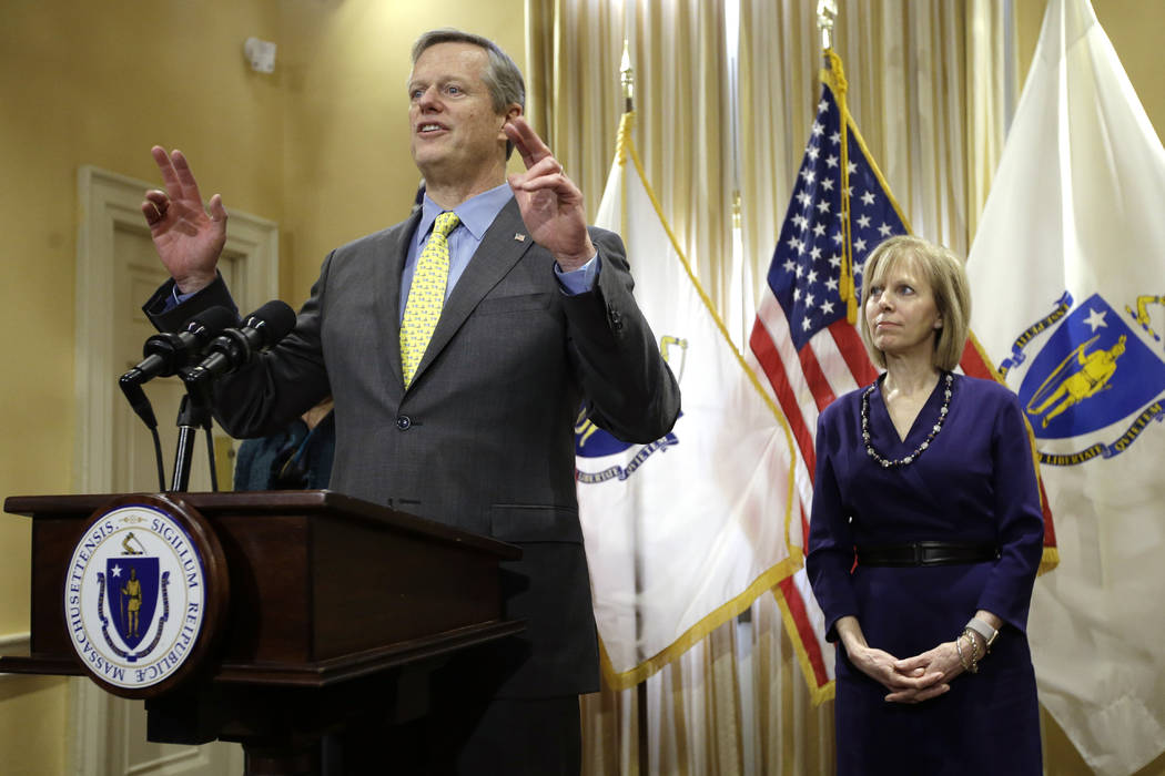Massachusetts Gov. Charlie Baker, left, faces reporters during a news conference held to announce the appointment of Cathy Judd-Stein, right, as the Chair of the Massachusetts Gaming Commission, T ...