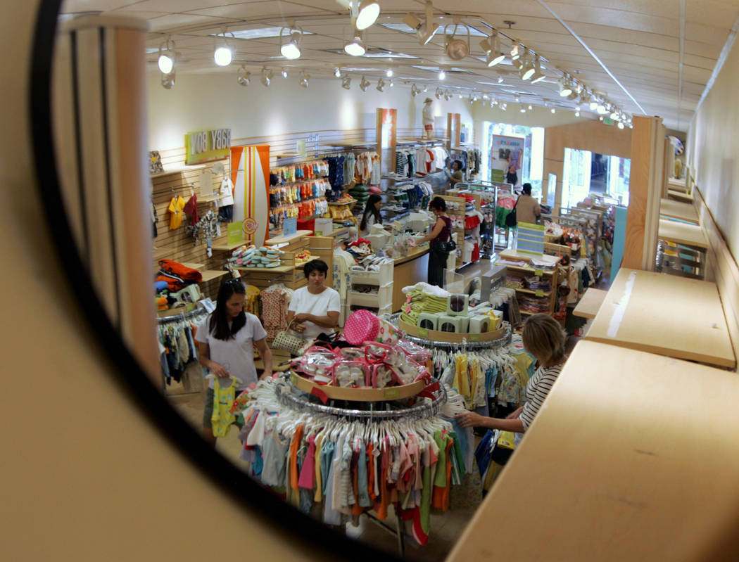 FILE- In this July 9, 2005, file photo a security mirror shows shoppers at a Gymboree store at Stanford Shopping Center in Palo Alto, Calif. Children's clothing retailer Gymboree has filed ...