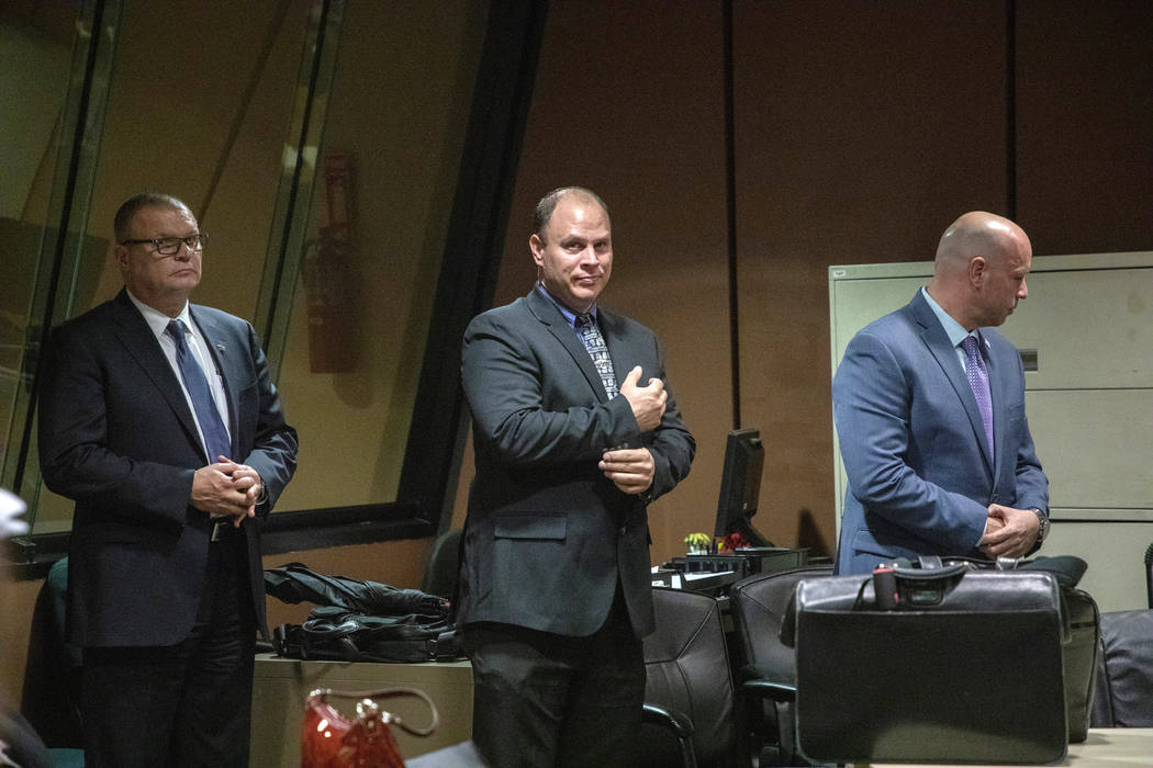 Former Detective David March, left, Chicago Police Officer Thomas Gaffney and former officer Joseph Walsh appear at a pre-trial hearing in Chicago, Oct. 30, 2018. The three Chicago police officers ...