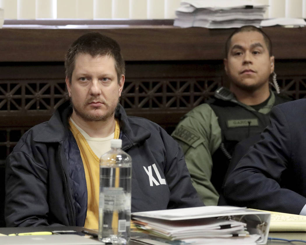 Former Chicago police Officer Jason Van Dyke, left, appears for a hearing at the Leighton Criminal Court Building in Chicago, Dec. 14, 2018. Van Dyke was convicted of second-degree murder and aggr ...