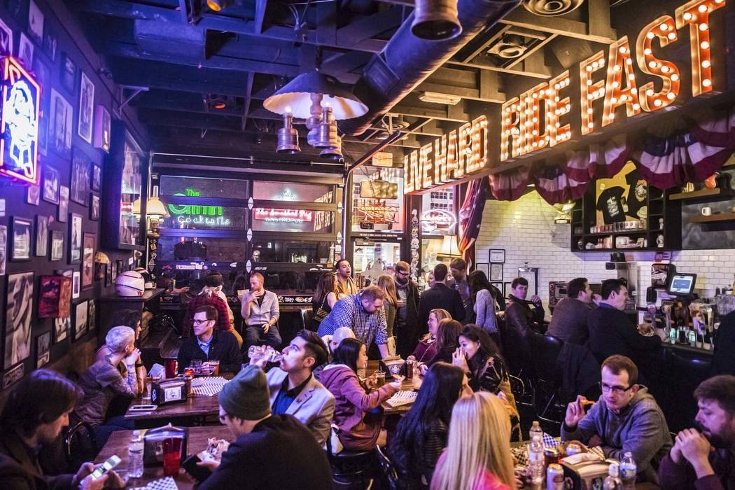 Diners eat and drink at Evel Pie, an Evel Knievel-themed pizzeria, on Fremont Street in downtown Las Vegas. (Benjamin Hager/Las Vegas Review-Journal)