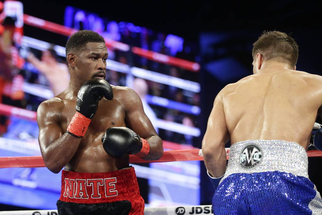 Daniel Jacobs, left, fights Ukraine's Sergiy Derevyanchenko during the fourth round of a IBF middleweight championship match Saturday, Oct. 27, 2018, in New York. Jacobs won the fight. (AP Photo/F ...