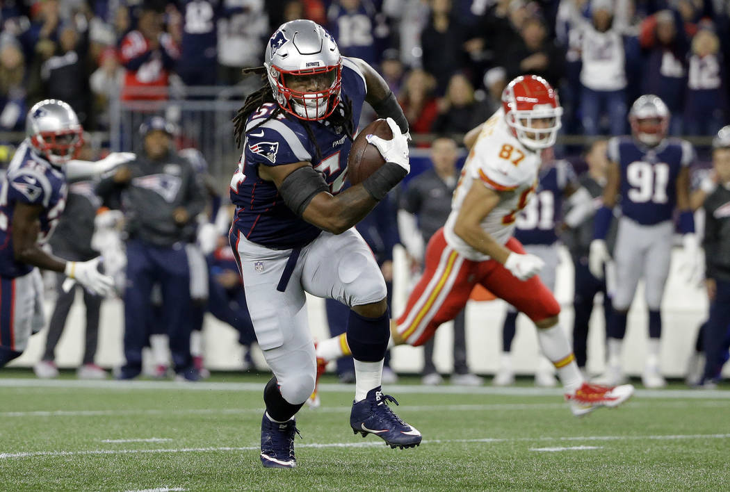 New England Patriots linebacker Dont'a Hightower runs with the ball after intercepting a pass by Kansas City Chiefs quarterback Patrick Mahomes during the first half of an NFL football game, Sunda ...