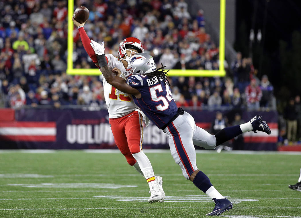 New England Patriots linebacker Dont'a Hightower (54) pressures Kansas City Chiefs quarterback Patrick Mahomes (15) as he tries to pass during the first half of an NFL football game, Sunday, Oct. ...