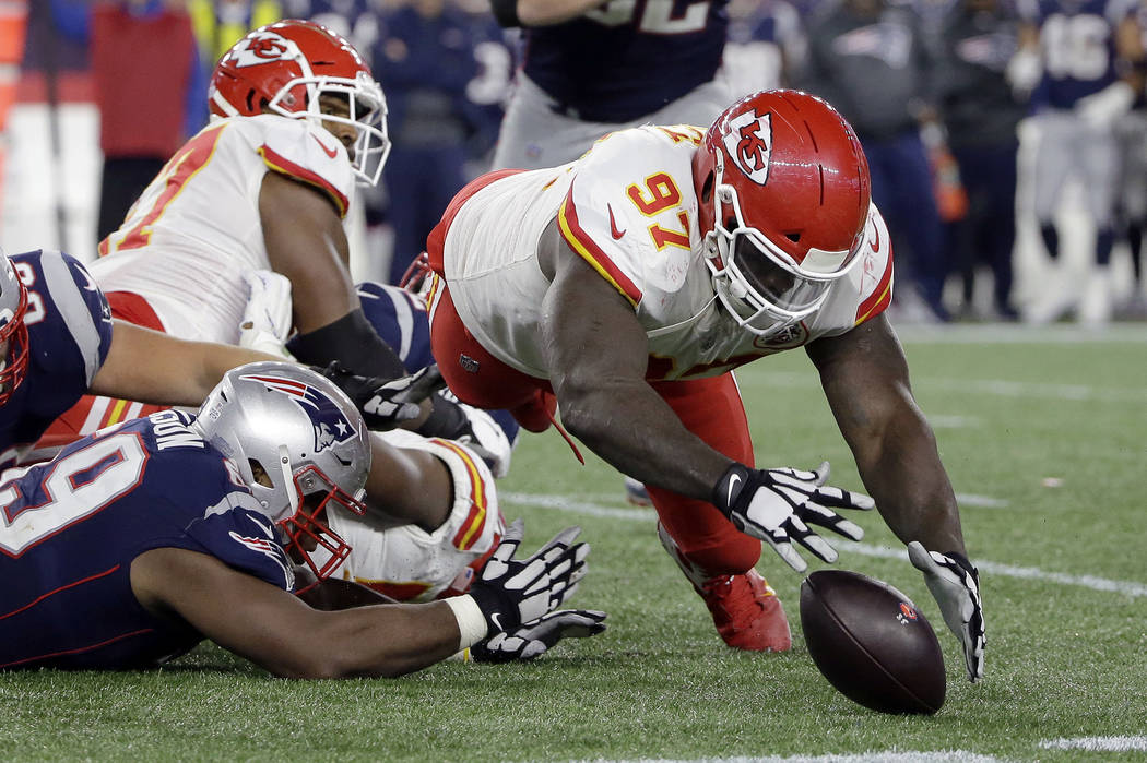 Kansas City Chiefs defensive end Allen Bailey (97) dives to recover a fumble by New England Patriots quarterback Tom Brady during the second half of an NFL football game, Sunday, Oct. 14, 2018, in ...