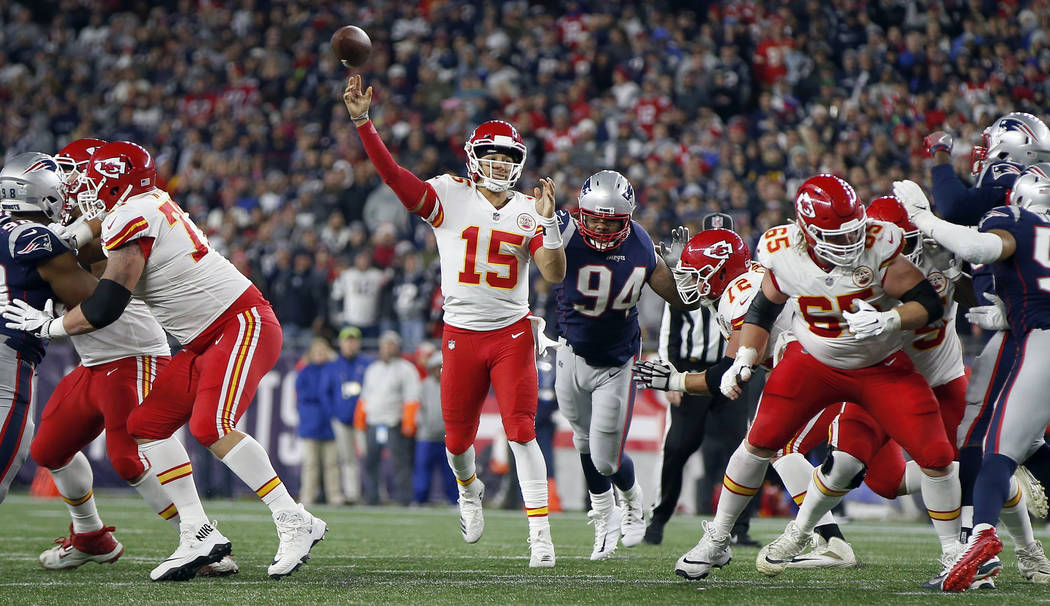 Kansas City Chiefs quarterback Patrick Mahomes (15) throws a touchdown pass to wide receiver Tyreek Hill (10) during the second half of an NFL football game against the New England Patriots, Sunda ...