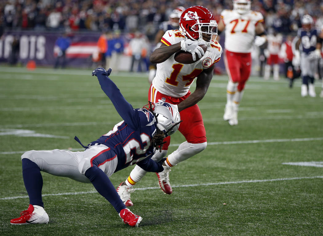 Kansas City Chiefs wide receiver Sammy Watkins (14) slips past New England Patriots defensive back Stephon Gilmore (24) after catching a pass during the second half of an NFL football game, Sunday ...