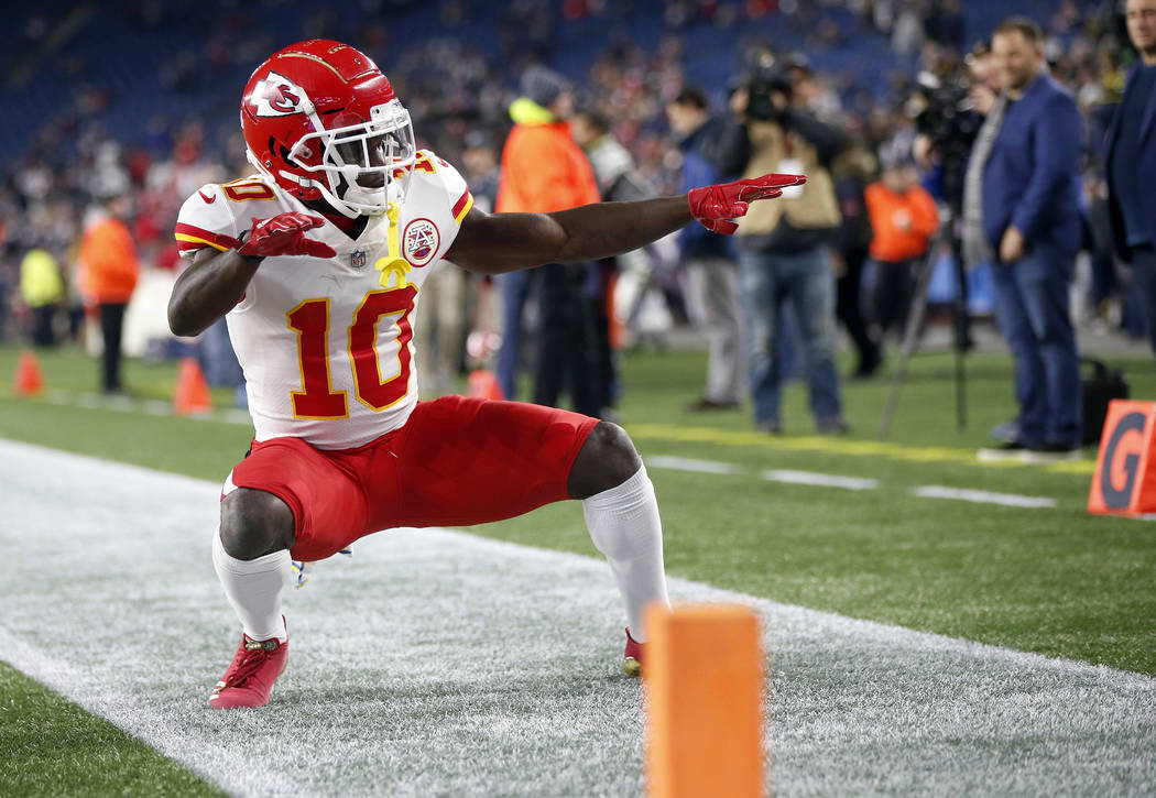 FILE - In this Sunday, Oct. 14, 2018, file photo, Kansas City Chiefs wide receiver Tyreek Hill strikes a pose as he warms up before an NFL football game against the New England Patriots in Foxboro ...