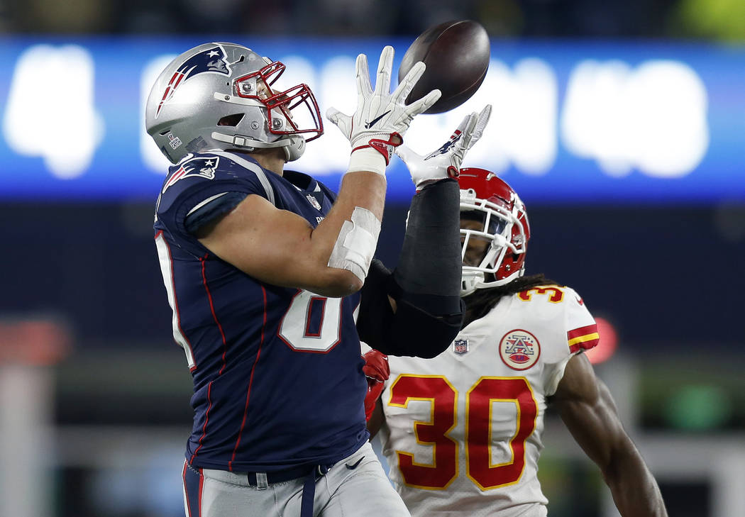 FILE - In this Sunday, Oct. 14, 2018, file photo, New England Patriots tight end Rob Gronkowski, left, catches a pass in front of Kansas City Chiefs safety Josh Shaw (30) during the second half of ...