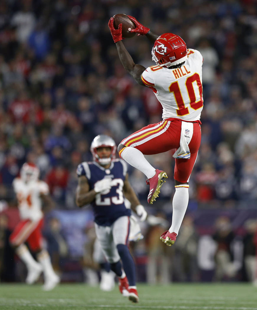 FILE - In this Oct. 14, 2018, file photo, Kansas City Chiefs wide receiver Tyreek Hill (10) catches a pass that he ran in for a touchdown during the second half of an NFL football game against the ...