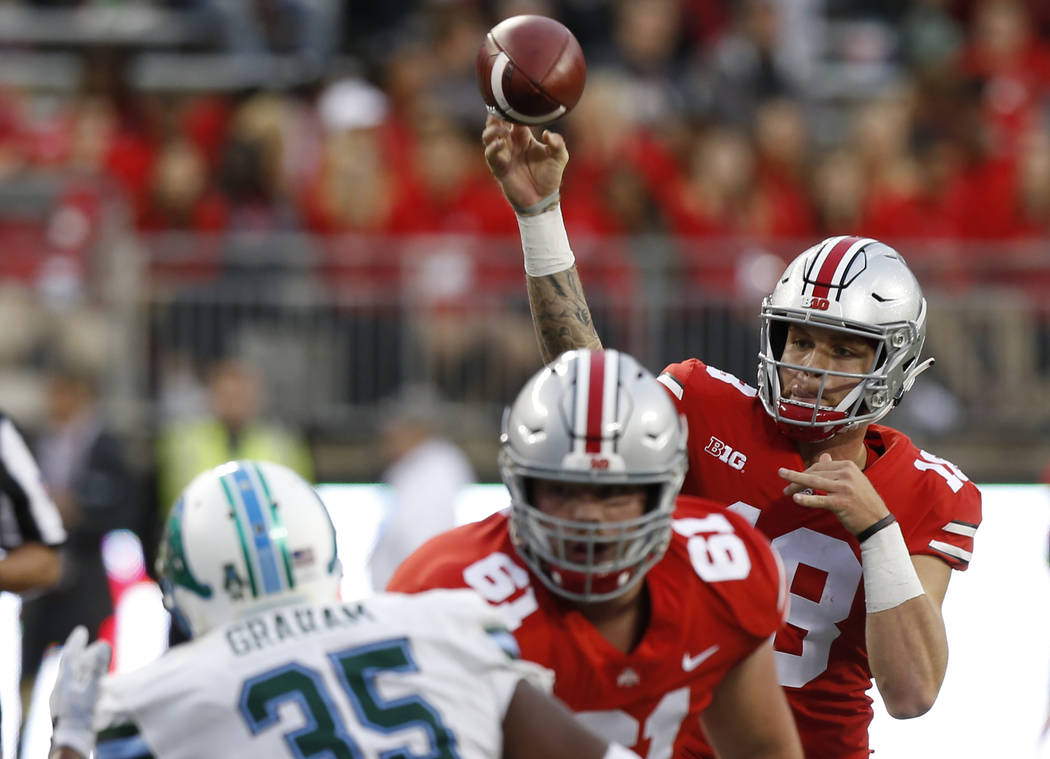 Ohio State quarterback Tate Martell throws a pass against Tulane during the second half of an NCAA college football game Saturday, Sept. 22, 2018, in Columbus, Ohio. Ohio State beat Tulane 49-6. ( ...