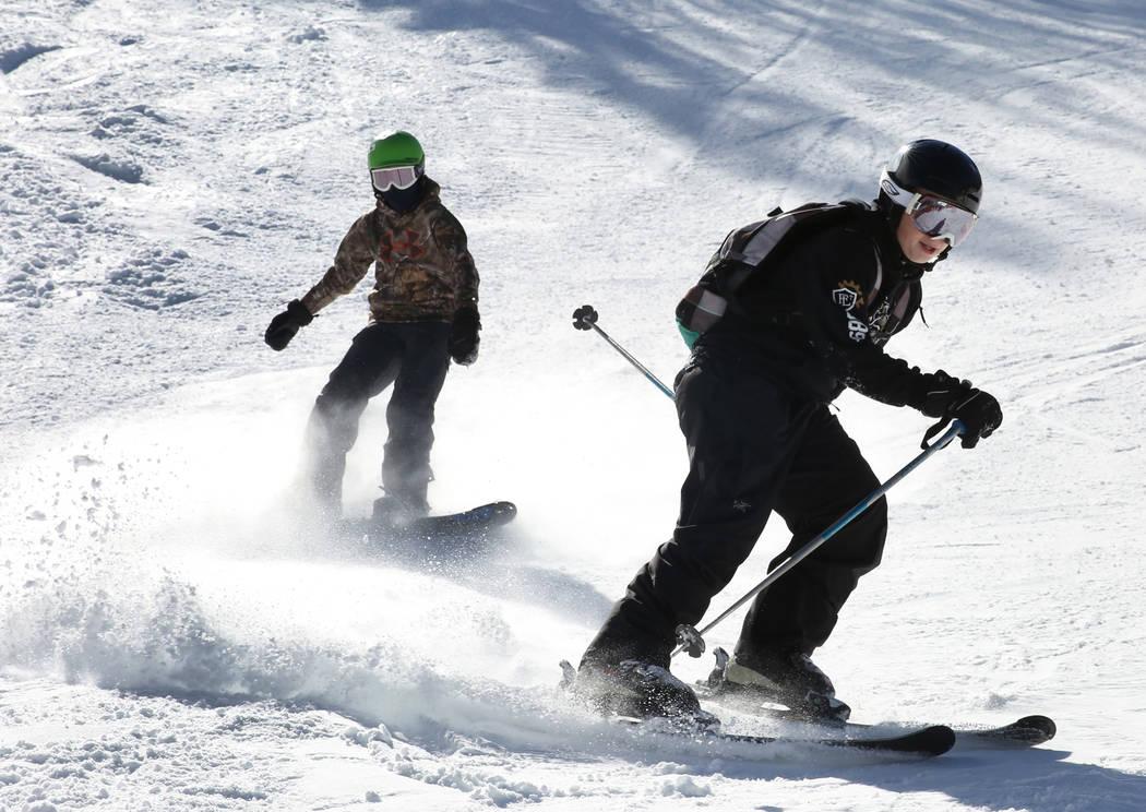 Jack Cape, 12, left, and Troy Jones, 13, boys of Las Vegas enjoy skiing and snowboarding at Lee Canyon on Friday, Jan. 18, 2019. Bizuayehu Tesfaye/Las Vegas Review-Journal @bizutesfaye
