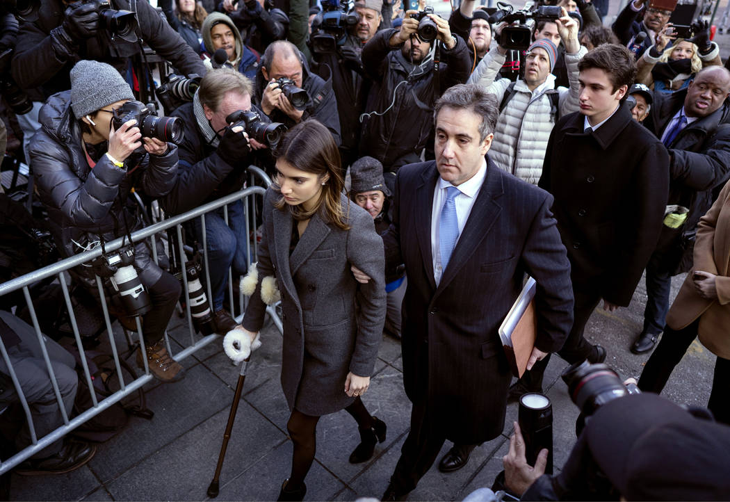 Michael Cohen, right, President Donald Trump's former lawyer, accompanied by his children, arrives at federal court for his sentencing for dodging taxes, lying to Congress and violating campaign f ...