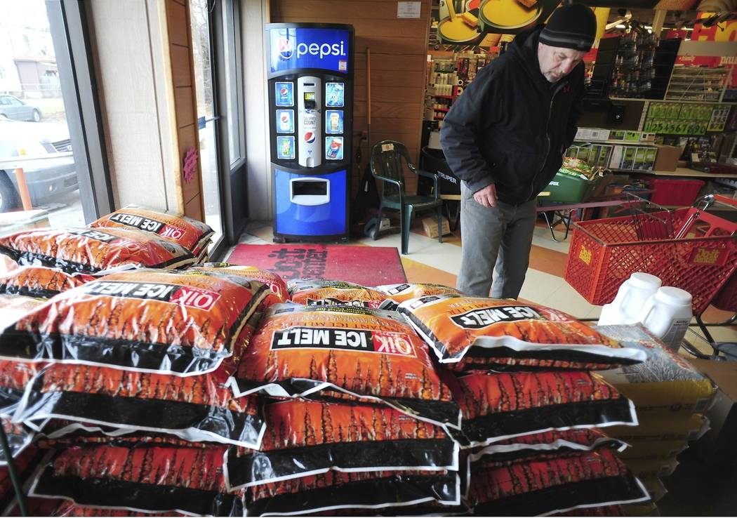 Customers purchase rock salt and ice melt Thursday, Jan. 17, 2019, at Walter's Hardware in Wilkes-Barre Township, Pa. Customers were also out purchasing rock salt and ice melt Thu, in preparation ...