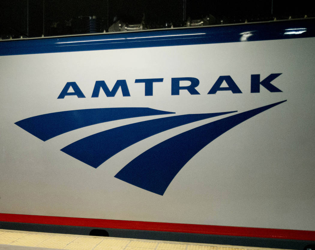 FILE - In this Feb. 6, 2014 file photo, an Amtrak logo is seen on a train at 30th Street Station in Philadelphia. Amtrak is modifying service in the Northeast and Midwest because of winter storms ...
