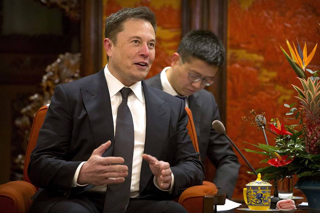 In this Jan. 9, 2019, file photo, Tesla CEO Elon Musk speaks during a meeting with Chinese Premier Li Keqiang at the Zhongnanhai leadership compound in Beijing. Electric car and solar panel maker ...