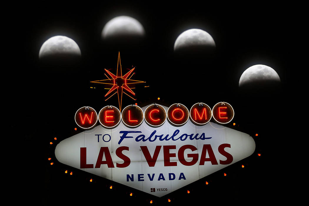 """This multiple-exposure photo captured on Sunday, Jan, 20, 2019, shows a super blood wolf moon's movement from Las Vegas Boulevard near famous """"Welcome to Fabulous Las Vegas"""" sign ..."""