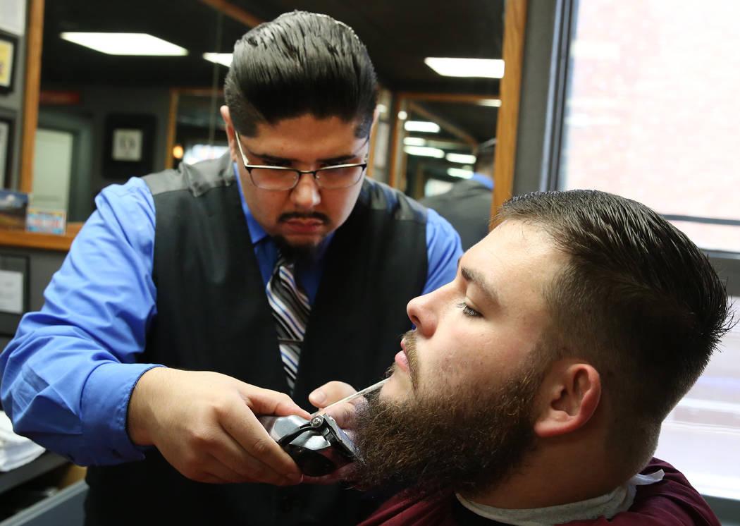Barber Andres Dominguez trims Kyle Lamb's beard at his Speakeasy Barbershop LV at El Cortez hotel-casino on Saturday, Jan. 19, 2019, in Las Vegas. Bizuayehu Tesfaye/Las Vegas Review-Journal @bizut ...
