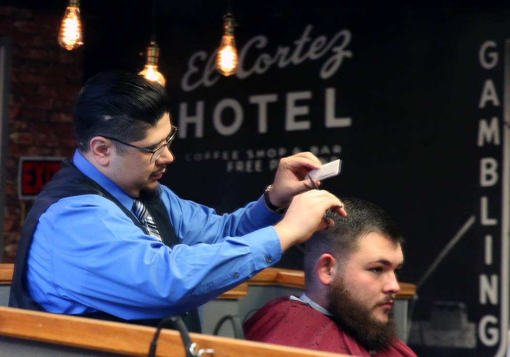 Barber Andres Dominguez cuts Kyle Lamb's hair at his Speakeasy Barbershop LV at El Cortez hotel-casino on Saturday, Jan. 19, 2019, in Las Vegas. Bizuayehu Tesfaye/Las Vegas Review-Journal @bizutesfaye