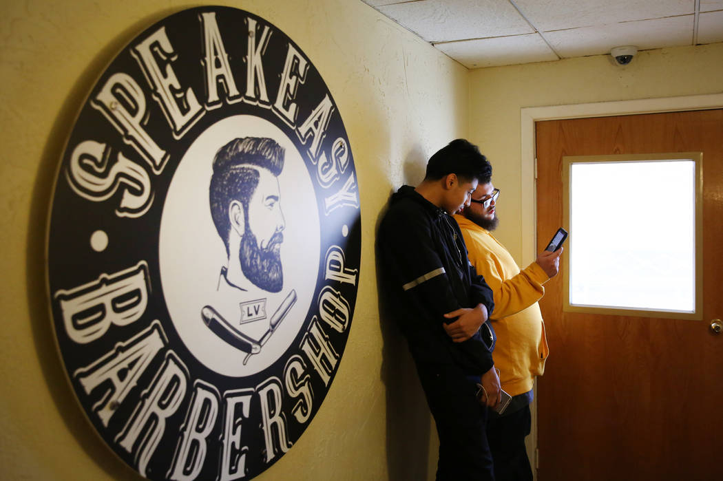 Cobe Chamorro, left, and Kyle Lamb wait for Speakeasy Barbershop LV to open at El Cortez hotel-casino on Saturday, Jan. 19, 2019, in Las Vegas. Bizuayehu Tesfaye/Las Vegas Review-Journal @bizutesfaye
