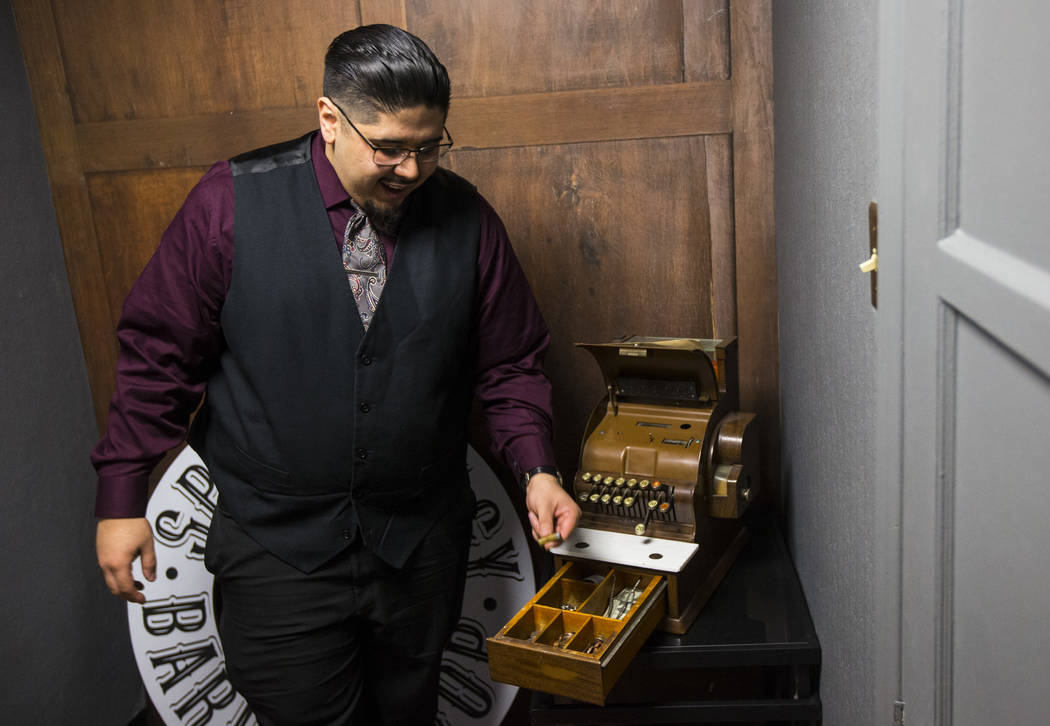Speakeasy Barbershop owner Andres Dominguez shows a bullet that he found in an old cash register handed down from his grandfather at his business at the El Cortez in downtown Las Vegas on Tuesday, ...
