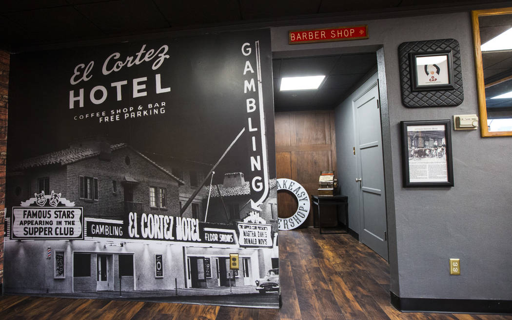 A mural with a historic image of the El Cortez on display next to an old barbershop sign at Speakeasy Barbershop at the hotel-casino in downtown Las Vegas on Tuesday, Jan. 15, 2019. Chase Stevens ...
