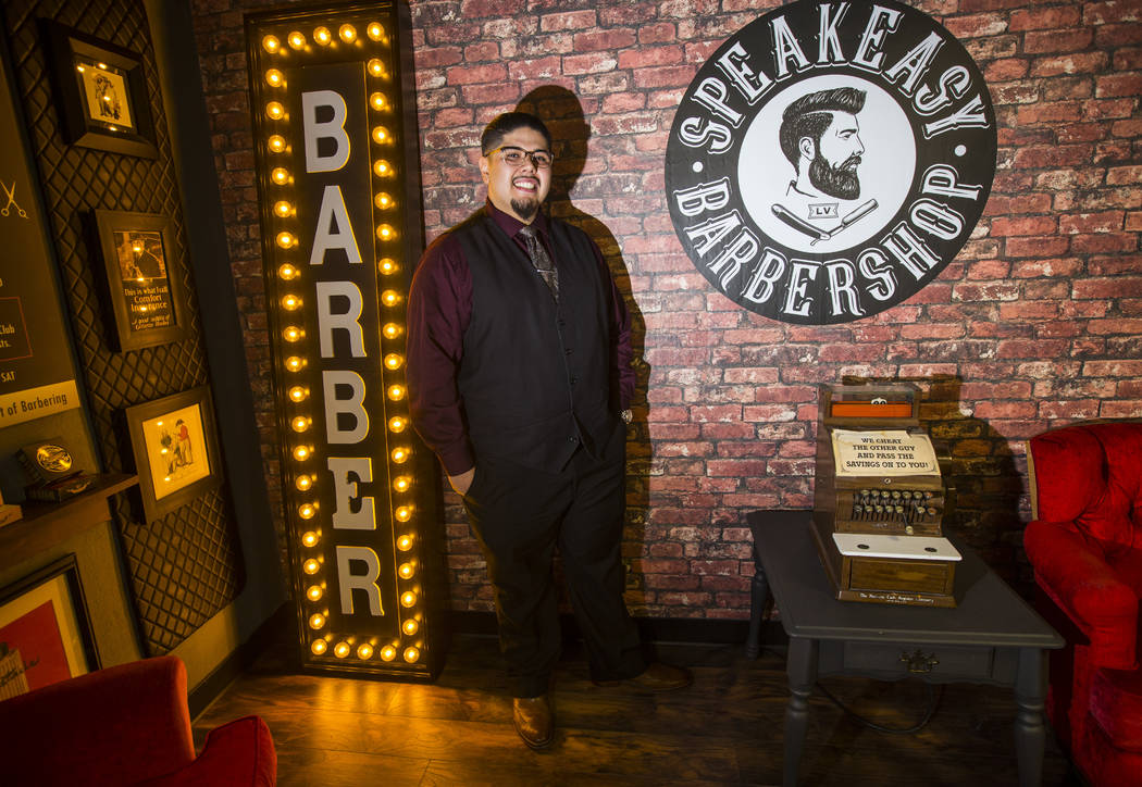 Speakeasy Barbershop owner Andres Dominguez poses for a portrait at his business at the El Cortez in downtown Las Vegas on Tuesday, Jan. 15, 2019. Dominguez's grandfather worked at the barbershop ...