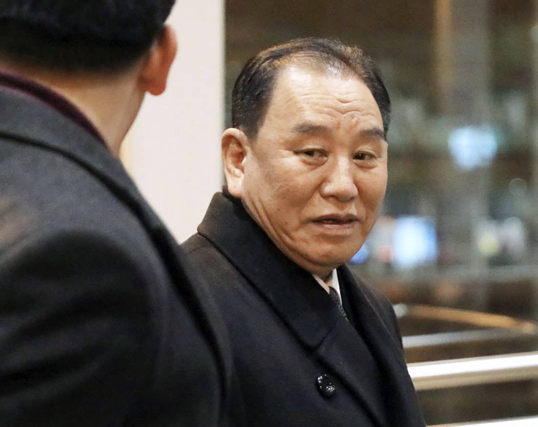 North Korean official Kim Yong Chol, right, prepares to leave the Beijing International Airport in Beijing Thursday, Jan. 17, 2019. (Kyodo News via AP)