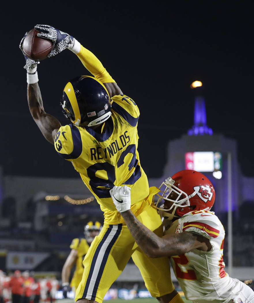 Los Angeles Rams wide receiver Josh Reynolds (83) catches a touchdown pass over Kansas City Chiefs defensive back Orlando Scandrick, lower right, during the first half of an NFL football game Mond ...