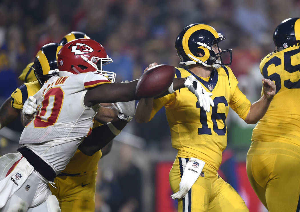 Kansas City Chiefs outside linebacker Justin Houston, left, strips the ball away from Los Angeles Rams quarterback Jared Goff (16) during the second half of an NFL football game, Monday, Nov. 19, ...