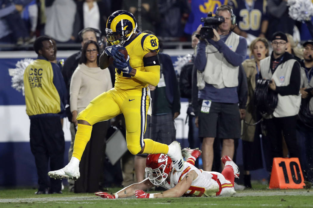 FILE - In this Monday, Nov. 19, 2018, file photo, Los Angeles Rams tight end Gerald Everett breaks away from Kansas City Chiefs defensive back Daniel Sorensen to score a touchdown during the secon ...