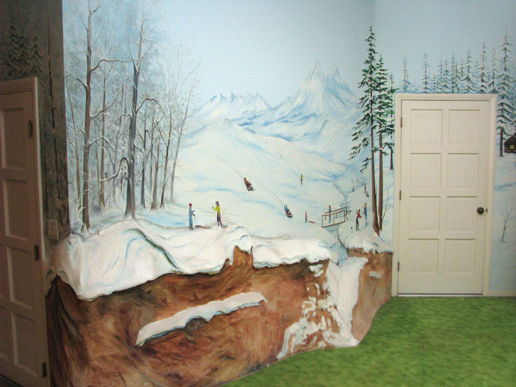 The underground house on Spencer Street includes murals that surround the underground yard. The murals include favorite places and seasons of the Hendersons, the family that had the home built. Th ...