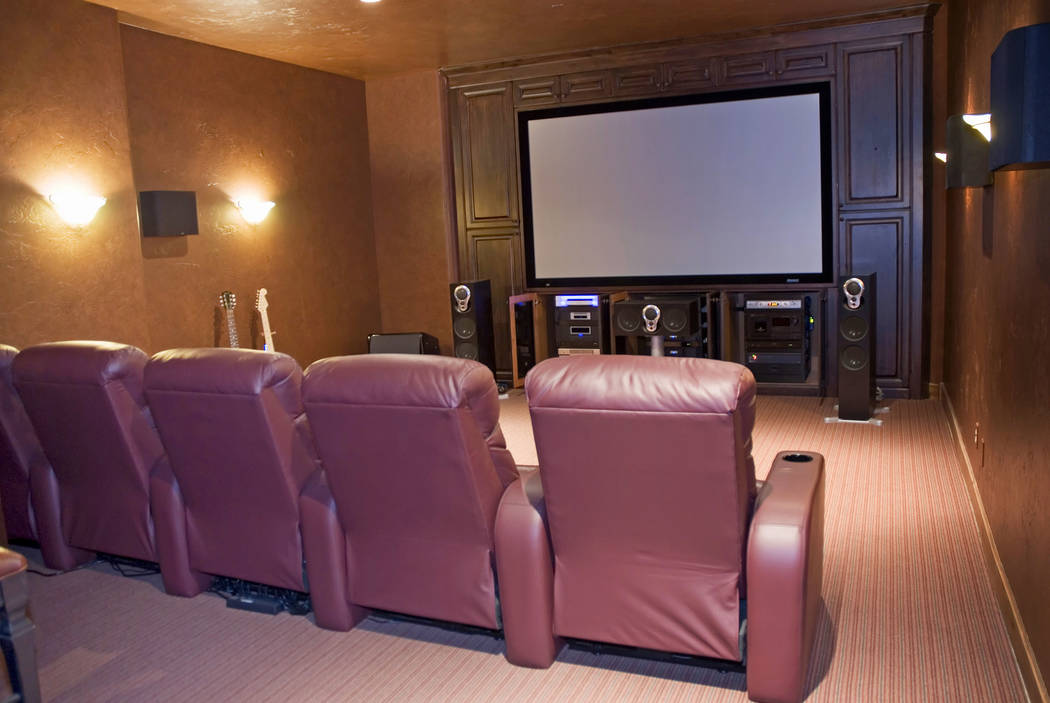 Theater-style seating faces the big-screen television is this home theater room. (Getty Images)