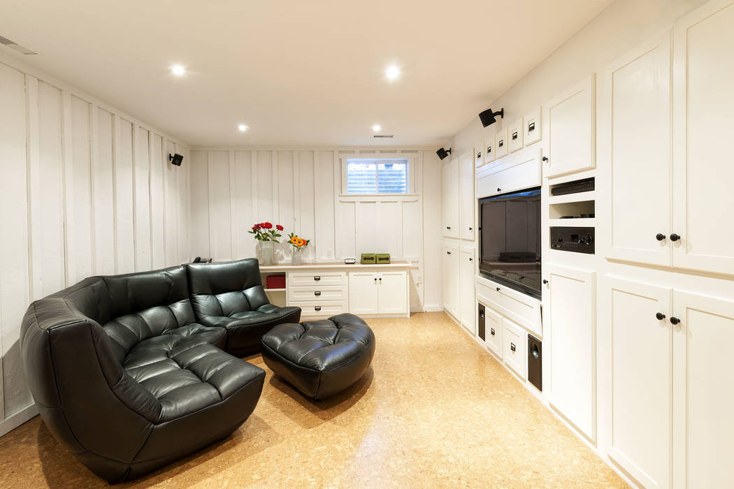 This residential entertainment center features a comfortable leather couch and flat screen television. (Getty Images)