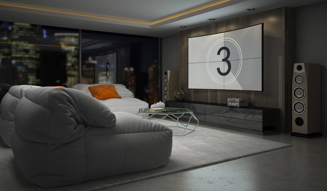 Apartments and condominiums may not have the space for a separate media room, but with comfortable seating and a large-screen TV, any room can provide that movie theater experience. (Getty Images)