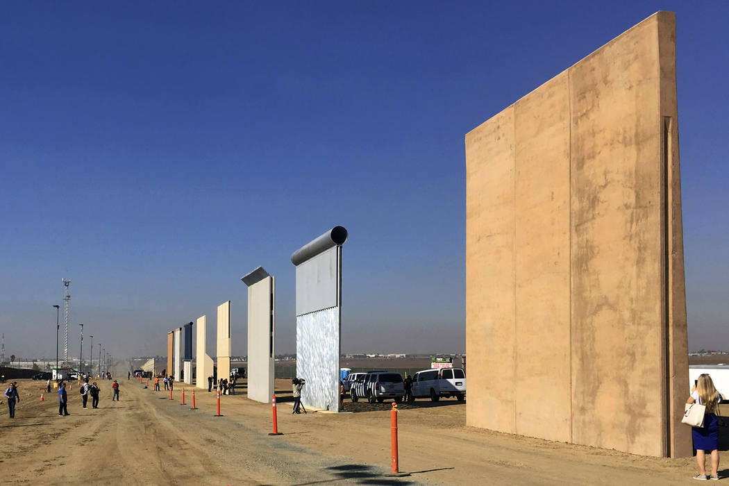 This Oct. 26, 2017 file photo shows prototypes of border walls in San Diego. The Trump administration has proposed spending $18 billion over 10 years to significantly extend the border wall with M ...