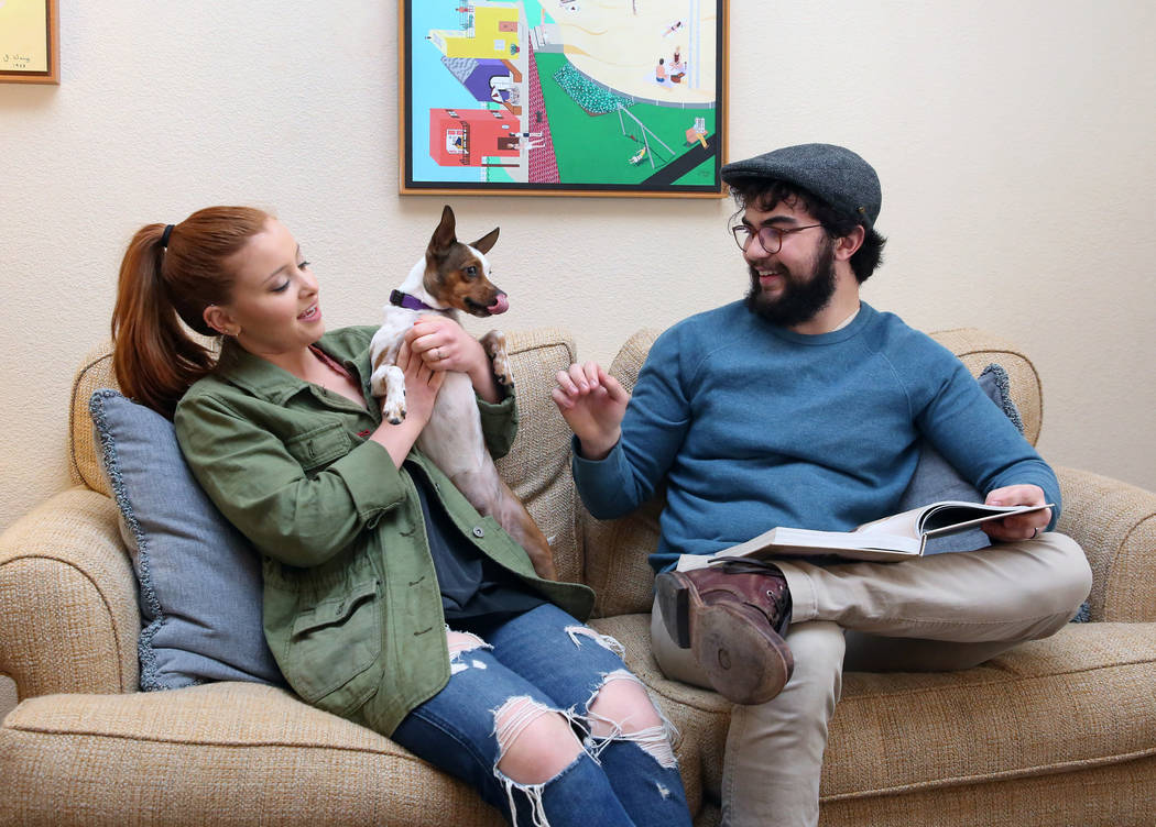 Emma Gould, 22, left, and her fiance Alex Weisz, 22, relax with their dog Winky at their Summerlin home on Tuesday, Jan. 22, 2019, in Las Vegas. Weisz and Gould moved from Los Angeles and bought t ...